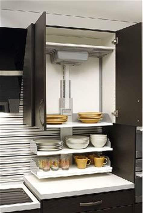 pull down kitchen cabinets for the disabled pull down shelves in an overhead cabinet are capable of