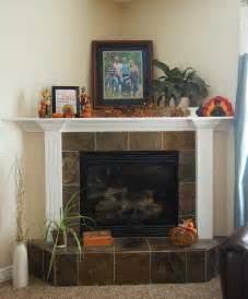Vanessa s fireplace with its tile base and deep corner top ledge is