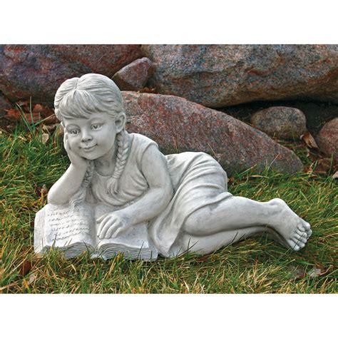 details  reading  book  girl garden sculpture