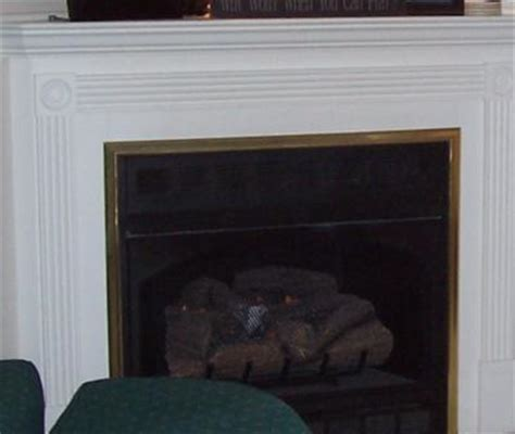 painting brass trim on a gas fireplace