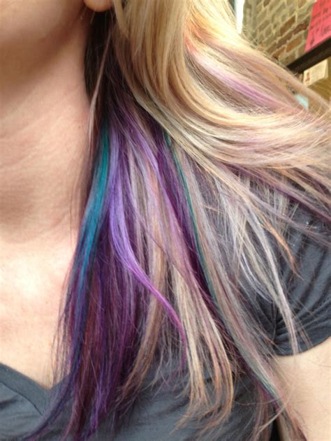hair color highlighted with dark color underneath teal by tressa and purple by pravana highlighted with