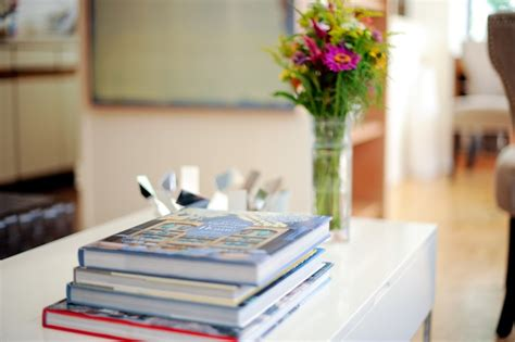 use coffee table books as decor fashionable hostess