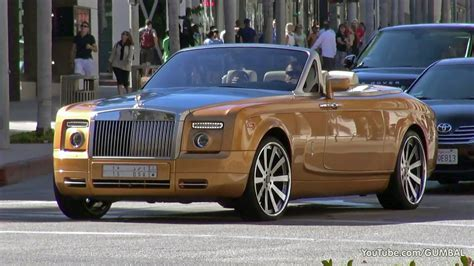 golden rolls royce arab rolls royce phantom drophead coupe with a gold spirit