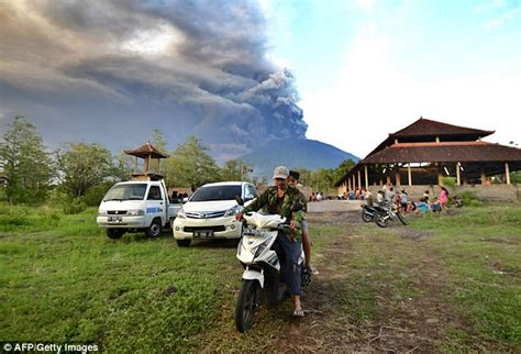 airasia volcano bali thousands flee bali as volcano mount agung spews ash
