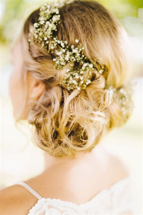 bridal hairstyles low bun with flowers vinatge rustic wedding hairstyle low bun updo with baby s
