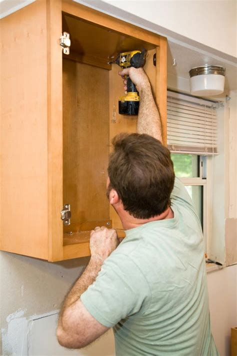 how to install kitchen wall cabinets how to install kitchen cabinets hometips