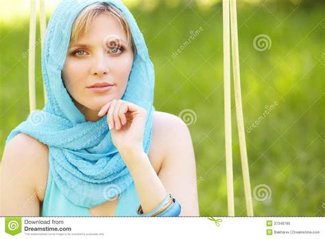 close up spread blonde slit outdoor portrait of a beautiful woman royalty free stock