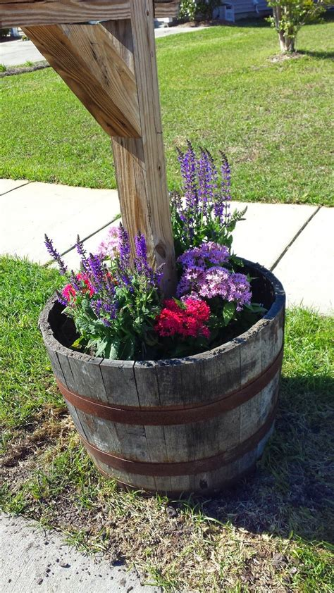 mailbox whiskey barrel filled with spring flowers home