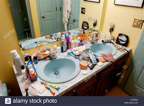 cluttered bathroom bathroom sinks cluttered with health and beauty products stock photo royalty free