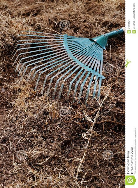 Landscape Soil Rake Yard Work Preparation Soil In Garden With Rake Stock
