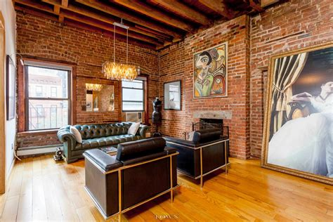 Decorating Ideas For Apartment Living Rooms A 32 Foot Long Living Room With Exposed Brick Dominates