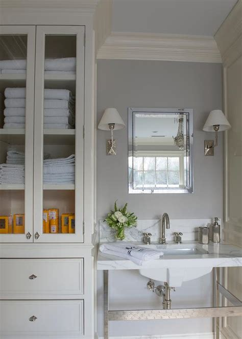 Ivory And Gray Bathroom With Glass Door Linen Cabinet