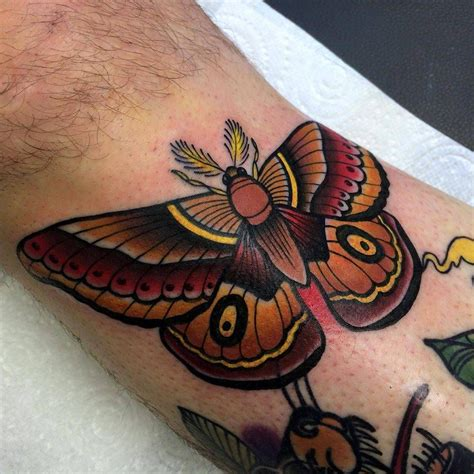 traditional moth tattoo neotraditional style butterfly on the right shin