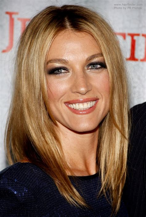 medium length hairstyles for hair parted in middle with bangs natalie zea with her long hair parted in the middle and