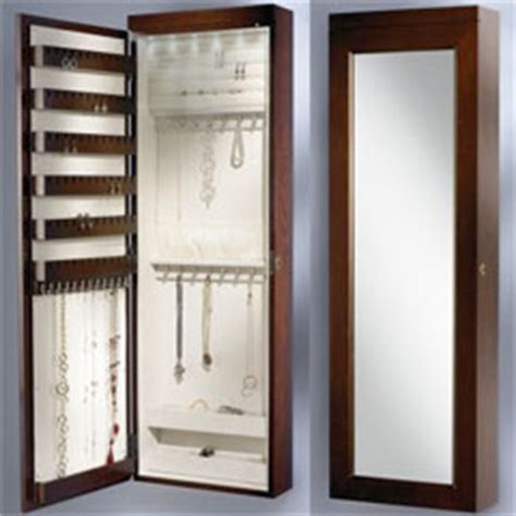 jewelry armoire safe wall mounted lighted jewelry armoire keeps 160 pieces clean safe and organized