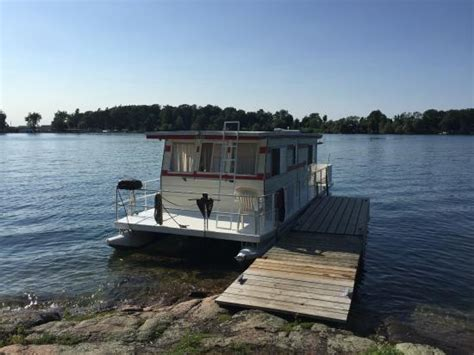 house boat holidays at the sandy beach swimming bay on leek island picture