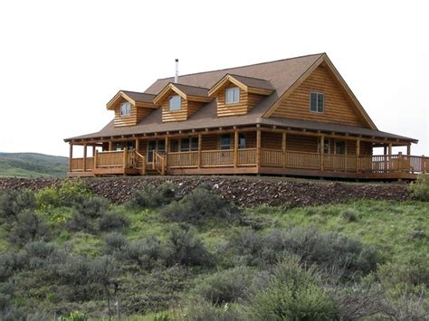 log homes with wrap around porches like the wrap around porch houses i like