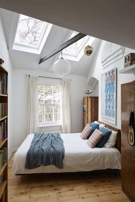 eclectic bedroom feels bigger   roof windows