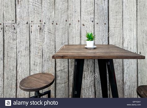 scheune vintage vintage wooden cafe table with a green flower on top in