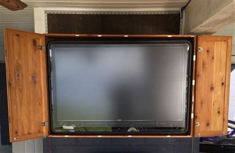 bi fold doors on a large cabinet tv cover wall by luckymargo
