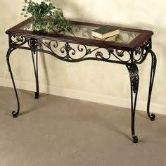 ornate wrought iron scroll console table with black marble