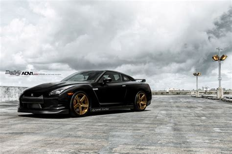 nissan gtr matte black gold rims black nissan gt r poses with gold adv 1 wheels gtspirit