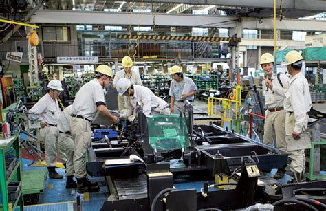 design manufacturing equipment co about us hitachi construction machinery