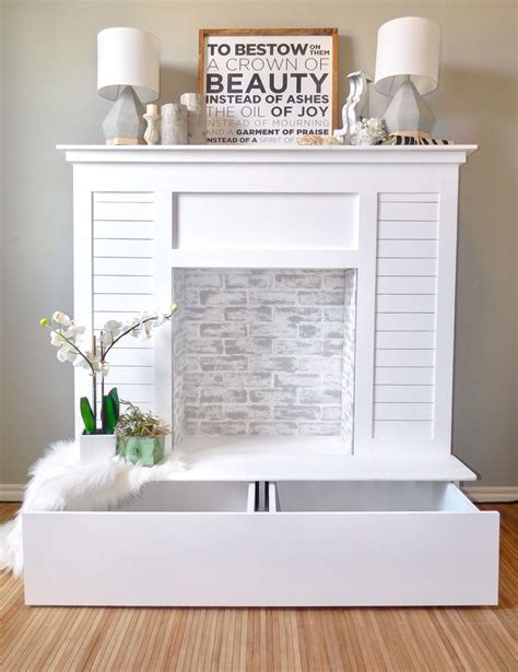 white faux fireplace with storage diy projects