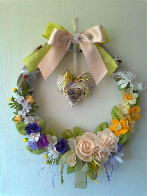 rami di fiori ghirlanda di rami di ulivo con fiori di pannolenci di