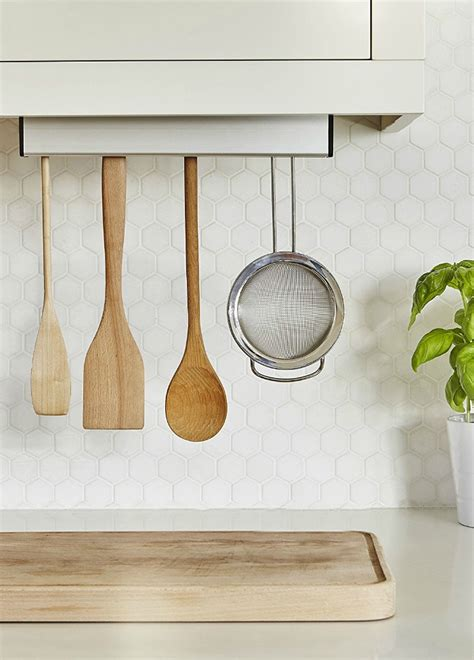 Cabinet Utensil Rack by Ten Smart Organizing Ideas For Your Kitchen Living In A
