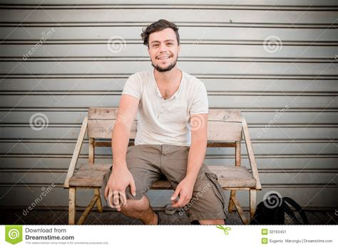 person sitting on a bench stylish man sitting on a bench stock image image 32163451