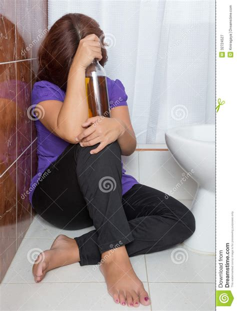 drunk in bathroom drunk woman sitting in the bathroom royalty free stock photography image 32724527