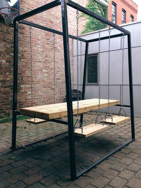 swing dining table swingset table adds a fun new dimension to your dining experience