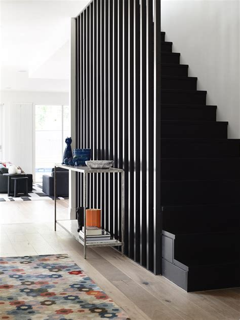 black staircase exploring pattern designs that make staircase screens