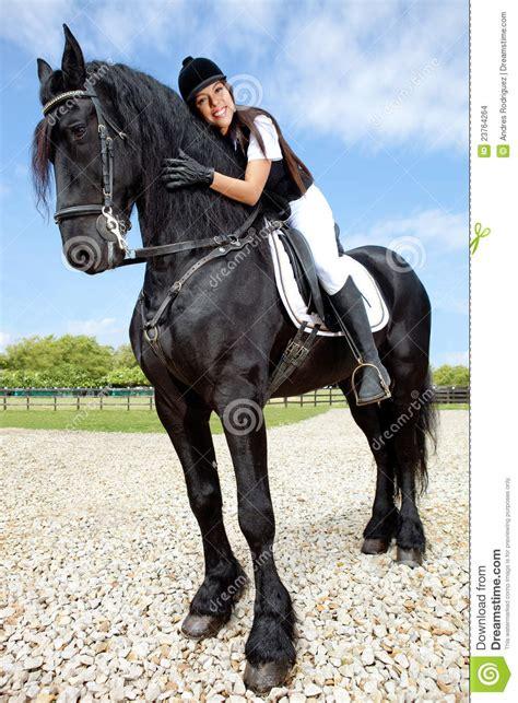 female jockey riding  horse stock photo image  people