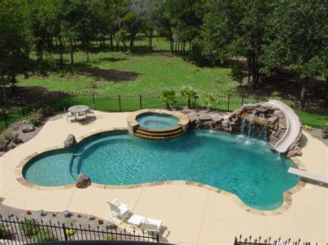 backyard swimming pool swimming pool slide diving board tub and waterfall