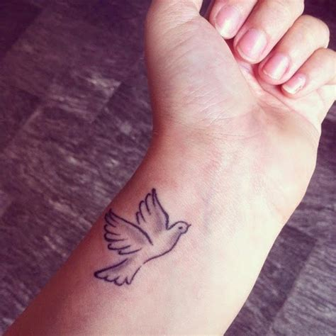 dove tattoos on wrist 49 creative dove tattoos on wrist