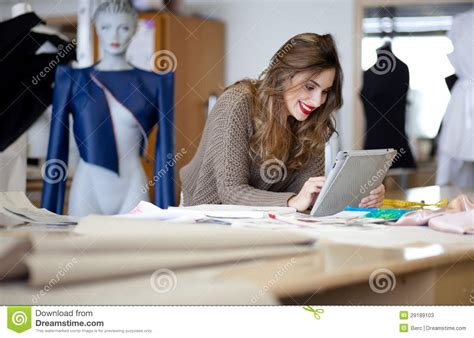 design clothes in computer fashion designer using tablet computer stock image image