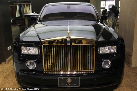 plated rolls royce rolling in it the 27 rolls royce phantom with gold