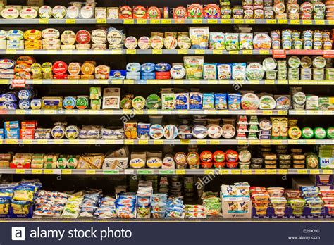 shelf with food in a supermarket milk products cheese