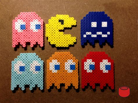 perler bead pacman pacman magnets and keychains made from perler by