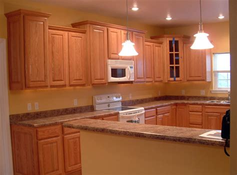 kitchen flooring ideas with oak cabinets kitchen w oak cabinets and floor 3 ak britton