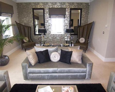 silver living room ideas photo of designer grey silver metallic living room lounge with pattern wallpaper and chairs