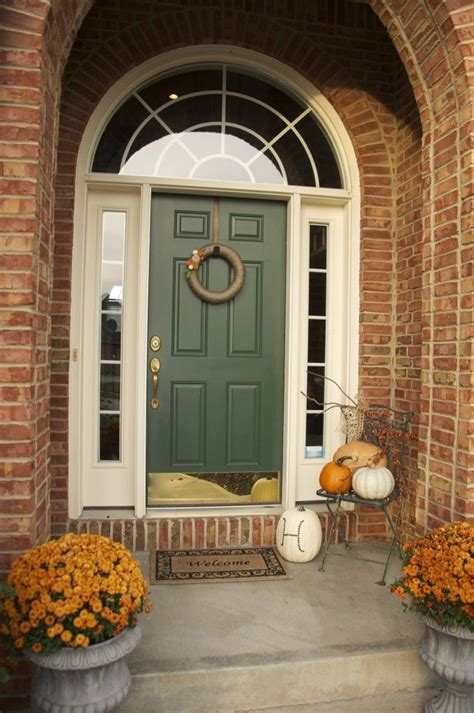 fall front porch green front door with the brick home exterior decor fall