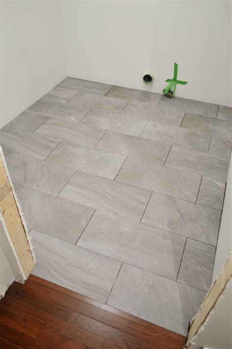 laying bathroom tile laying porcelain tile in the laundry room young house love