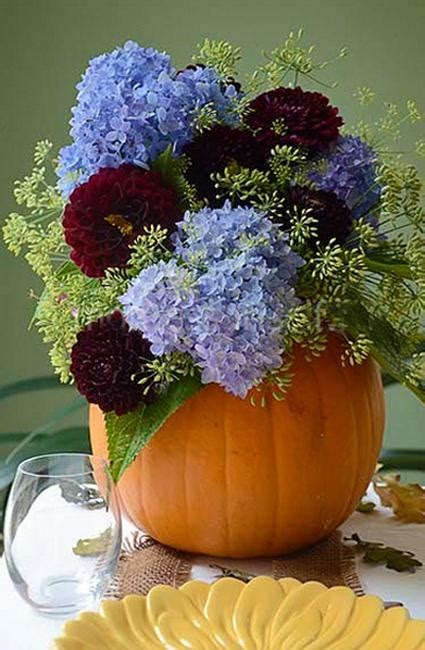 vibrant pumpkin vases  flower arrangements thanksgiving table centerpiece ideas