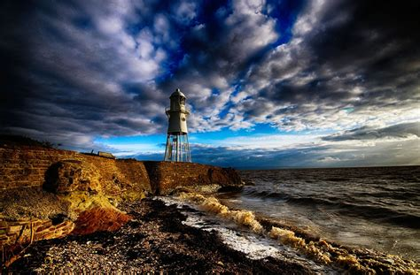 beach lighthouse england sea clouds walls coast