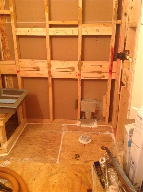 framing a shower bench barebones after wall tile tub is removed frame in