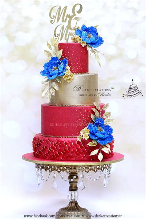 red gold wedding cake  royal blue flowers