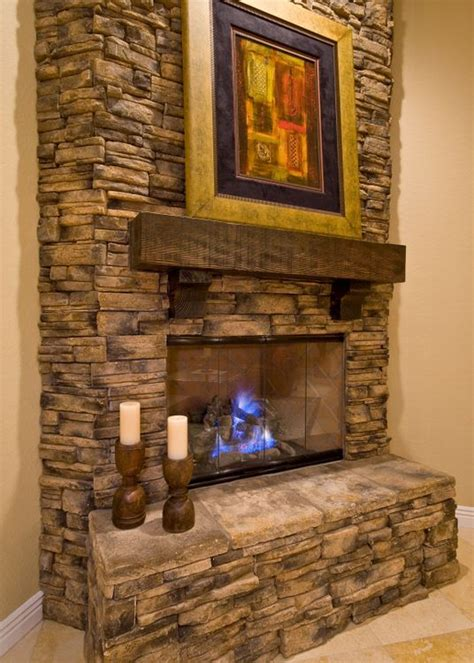 stacked rock fireplace kitchen family room